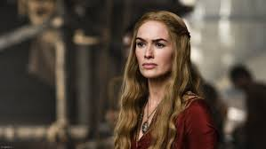Image of Cersei Lannister, a character in the Game of Thrones tv show, a middle-aged woman with long blonde hair with a stern gaze.