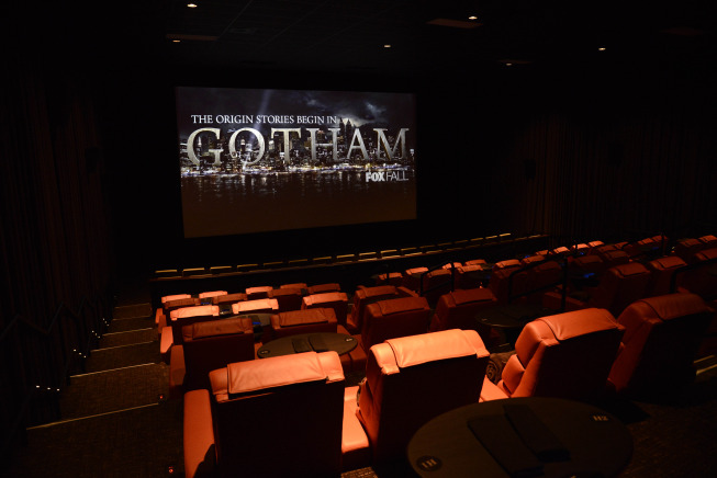 Image of a movie theatre with the following on the screen: The origin stories being in  GOTHAM FOX Fall
