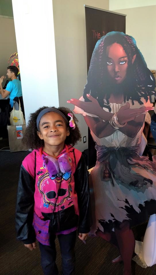 My daughter, for one of the first times ever, was able to go with me to a con and see images and experience stories that reflected her and her experience.