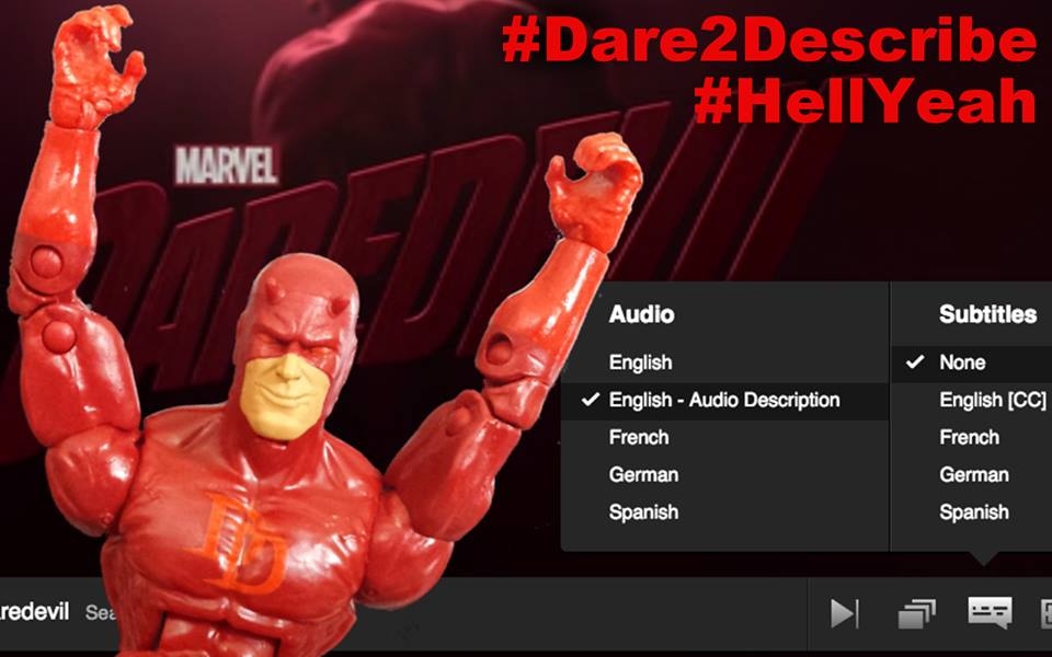 "A smiling Daredevil action figure sits in front of a computer monitor, arms raised above his head triumphantly. The opening sequence from the Netflix series Marvel's Daredevil plays on the screen behind him with a newly added audio track selected in the settings menu that reads: ""ENGLISH - AUDIO DESCRIPTION."" In the corner are two hashtags in red text: ‪#‎Dare2Describe‬ ‪#‎HellYeah‬"